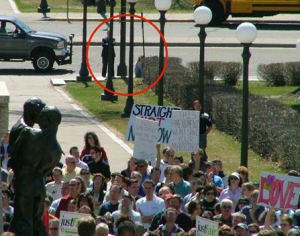 Michele_Bachmann_hiding_at_gay_rights_rally